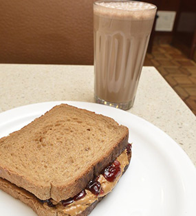 PeanutButter Sandwich With Glass Of Chocolat Milk