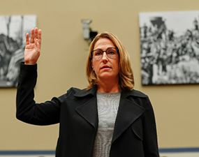Mylan CEO Heather Bresch with arm raised for 'sworn' testimony