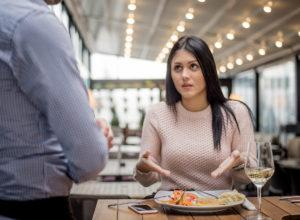 A woman and friend in a restaurant with food